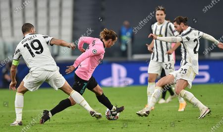 Stock Image of Juventus' Leonardo Bonucci (L) and Barcelona's Antoine Griezmann (C) in action during the UEFA Champions Legue soccer match between Juventus FC and FC Barcelona, in Turin, Italy, 28 October 2020.