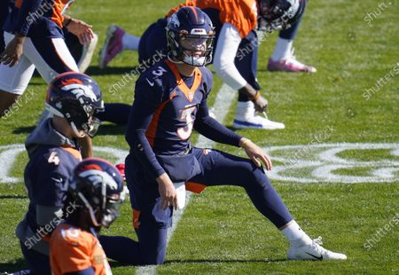 Denver Broncos quarterback Drew Lock stretches during NFL football practice, at the team's headquarters in Englewood, Colo