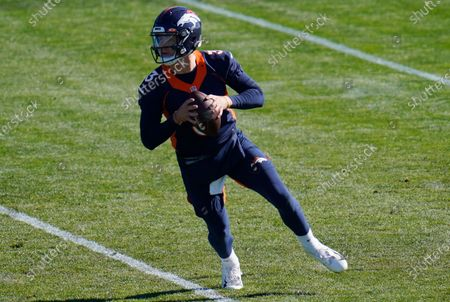 Denver Broncos quarterback Drew Lock takes part in drills during an NFL football practice, at the team's headquarters in Englewood, Colo