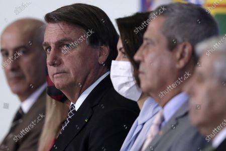 Brazil's President Jair Bolsonaro, accompanied by his wife Michelle Bolsonaro, attend a ceremony to commemorate Public Servant Day, at the Planalto Presidential Palace in Brasilia, Brazil