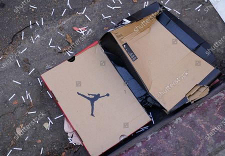 Box that held Air Jordan sneakers lies in the street near a Foot Locker store that was looted and vandalized during last night's fan celebrations following the Los Angeles Dodgers' World Series win, in Los Angeles