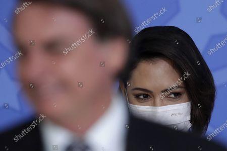 First lady Michelle Bolsonaro accompanies her husband Brazil's President Jair Bolsonaro, to a ceremony to commemorate Public Servant Day, at the Planalto Presidential Palace in Brasilia, Brazil