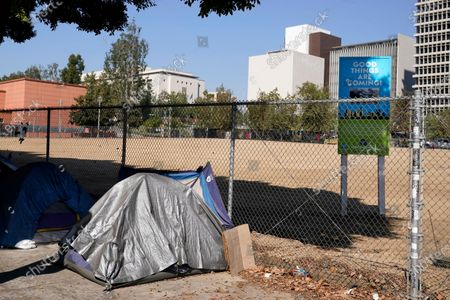 A homeless person's tent sits just outside Grand Park, in Los Angeles. Los Angeles is again considering a proposal to greatly restrict where homeless people may camp in public places around Los Angeles - rules that opponents say would criminalize homelessness