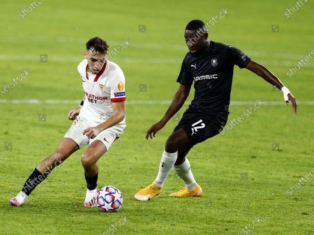 Munir el Haddadi of Sevilla FC and James Lea Siliki of Rennes