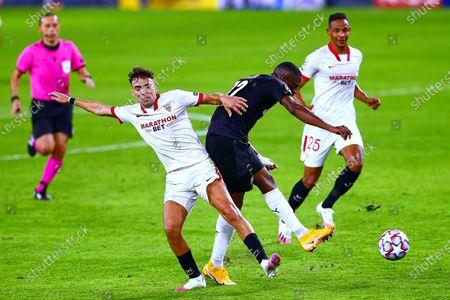 James Lea Siliki of Rennes and Munir El Haddadi of Sevilla FC