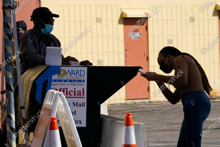 Woman drops a vote-by-mail ballot into an official ballot drop box at the Broward County Voting Equipment Center, in Lauderhill, Flastockfényképe