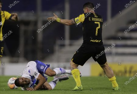 Stock Picture of Adrian Centurion of Argentina's Velez Sarsfield, left, reacts after being fouled by Cristian Rodriguez of Uruguay's Penarol during their Copa Sudamericana soccer match in Buenos Aires, Argentina