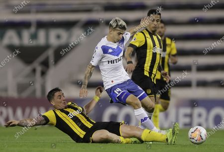 Cristian Rodriguez of Uruguay's Penarol, left, and Luca Orellano of Argentina's Velez Sarsfield, battle for the ball during their Copa Sudamericana soccer match in Buenos Aires, Argentina