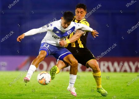 Cristian Rodriguez of Uruguay's Penarol, right, and Pablo Galdames of Argentina's Velez Sarsfield, battle for the ball during their Copa Sudamericana soccer match in Buenos Aires, Argentina
