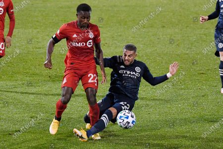 Stock Image of Toronto FC's Richie Laryea, left, is challenged by New York City FC's Ronald Matarrita during the second half of an MLS soccer match, in East Hartford, Conn