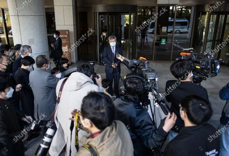 Kang Hoon (C,top), a lawyer for South Korea's former President Lee Myung-bak, answers reporters' questions at the Supreme Court in Seoul, South Korea, 29 October 2020. South Korea's top court upheld a lower court ruling of a 17-year prison term for Lee for embezzlement and bribery.