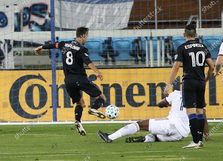San Jose Earthquakes forward Chris Wondolowski (8) scores a goal against Real Salt Lake during the first half of an MLS soccer match, in San Jose, Calif