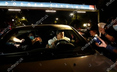Los Angeles Dodgers' Enrique Hernández drives away from Dodger Stadium in Los Angeles, after the team's return. The Dodgers defeated the Tampa Bay Rays in the baseball World Series in Arlington, Texas