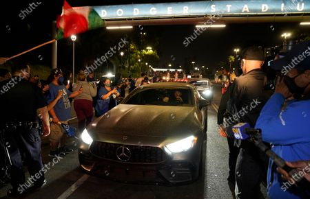 Los Angeles Dodgers pitcher Alex Wood drives off from Dodger Stadium in Los Angeles, after the Dodgers returned to Los Angeles after defeating the Tampa Bay Rays in the baseball World Series in Arlington, Texas