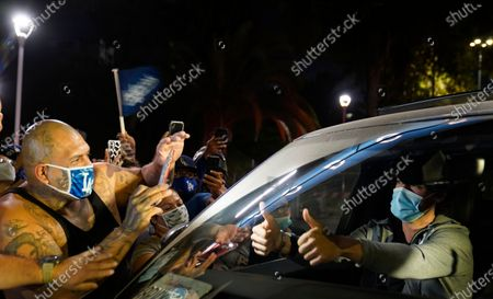 Los Angeles Dodgers' Cody Bellinger gives thumbs-up to fans, as he leaves Dodger Stadium in Los Angeles on Wednesday night, after the Dodgers returned to Los Angeles following their win over the Tampa Bay Rays in the baseball World Series in Arlington, Texas