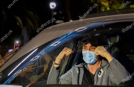 Los Angeles Dodgers Cody Bellinger cheers fans, as he's driven off Dodger Stadium in Los Angeles Wednesday night, after the Dodgers returned from Arlington, Texas, where they defeated the Tampa Bay Rays in the baseball World Series