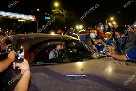Los Angeles Dodgers pitcher Julio Urías stops for fans, as he leaves Dodger Stadium in Los Angeles, after the Dodgers returned from Arlington, Texas, where they defeated the Tampa Bay Rays in the baseball World Series