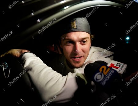Los Angeles Dodgers' Enrique Hernández pauses while departing Dodger Stadium in Los Angeles on . The Dodgers returned after defeating the Tampa Bay Rays in the baseball World Series in Arlington, Texas