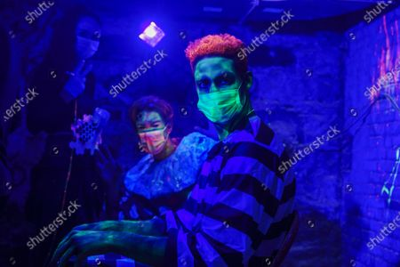 Stock Picture of Joshua 'Zeke' Thomas and Colt Walker prepare their gig at Blood Manor Haunted Attraction in Soho area, New York.