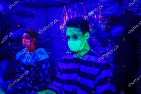 Stock Photo of Joshua 'Zeke' Thomas prepares for his gig at Blood Manor Haunted Attraction in Soho area, New York.