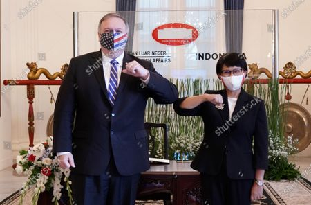 Stock Photo of In this photo released by Indonesian Ministry of Foreign Affairs, U.S. Secretary of State Mike Pompeo, left, and Indonesian Foreign Minister Retno Marsudi pose for photographers during their meeting in Jakarta, Indonesia, . Pompeo renewed the Trump administration's rhetorical onslaught against China in Indonesia on Thursday as the American presidential election looms