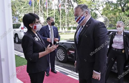 In this photo released by Indonesian Ministry of Foreign Affairs, Indonesian Foreign Minister Retno Marsudi, left, talks to U.S. Secretary of State Mike Pompeo, right, upon his arrival for their meeting in Jakarta, Indonesia, . Pompeo renewed the Trump administration's rhetorical onslaught against China in Indonesia on Thursday as the American presidential election looms