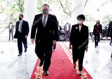 Stock Image of In this photo released by Indonesian Ministry of Foreign Affairs, U.S. Secretary of State Mike Pompeo, center left, walks with Indonesian Foreign Minister Retno Marsudi during their meeting in Jakarta, Indonesia, . Pompeo renewed the Trump administration's rhetorical onslaught against China in Indonesia on Thursday as the American presidential election looms