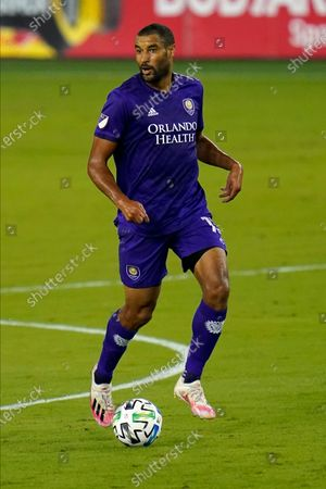 Orlando City forward Tesho Akindele looks to pass the ball against Atlanta United during the first half of an MLS soccer match, in Orlando, Fla