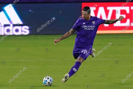 Orlando City defender Antonio Carlos passes the ball during the first half of an MLS soccer match against Atlanta United, in Orlando, Fla