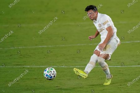 Atlanta United defender Fernando Meza passes the ball against Orlando City during the second half of an MLS soccer match, in Orlando, Fla