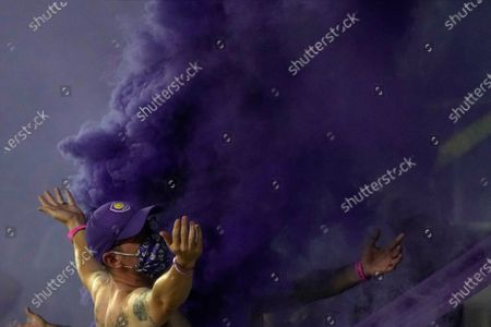 Fans celebrate after Orlando City scored a goal against Atlanta United during the second half of an MLS soccer match, in Orlando, Fla