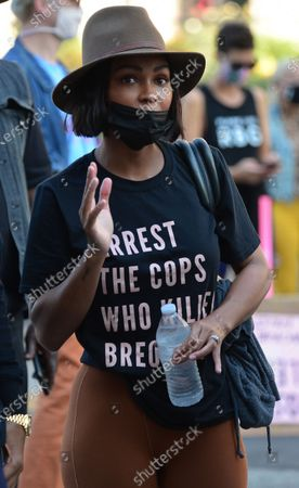 Actress Meagan Good wears a shirt in honor of Breonna Taylor as she joins Terrence J and Kendrick Sampson at the Black Lives Matter protest and ballot drive against DA Jackie Lacey