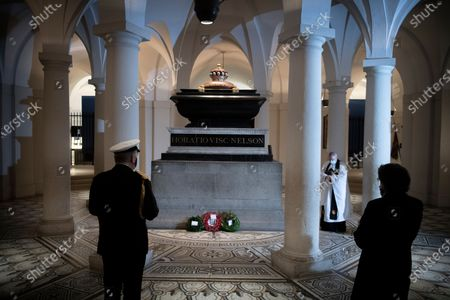 Lord Alan West laying a wreath at Nelson's tomb in the Crypt at St Pauls for Trafalgar Day
