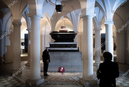 Stock Image of Lord Alan West laying a wreath at Nelson's tomb in the Crypt at St Pauls for Trafalgar Day