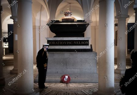 Stock Photo of Lord Alan West laying a wreath at Nelson's tomb in the Crypt at St Pauls for Trafalgar Day