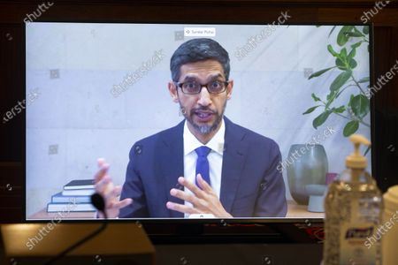 """Sundar Pichai, CEO of Google and Alphabet, is seen on a screen during the hearing of U.S. Senate Committee on Commerce, Science, and Transportation titled """"Does Section 230's Sweeping Immunity Enable Big Tech Bad Behavior?"""" on Capitol Hill in Washington, D.C., the United States, on Oct. 28, 2020."""