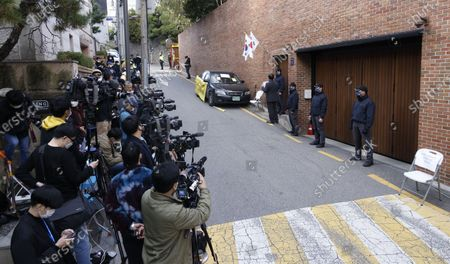 Journalist wait for waiting former South Korean President Lee Myung-bak in front of the former president's house in Seoul, South Korea, 29 October 2020. South Korea's Supreme Court upheld a lower court ruling of a 17-year prison term for Lee, who was charged with embezzlement and bribery.