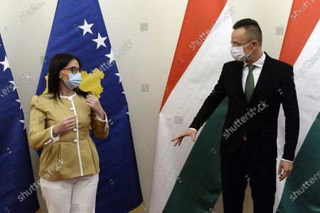 Kosovar Minister of Foreign Affairs and Diaspora Meliza Haradinaj-Stublla (L) and Hungarian Minister of Foreign Affairs and Trade Peter Szijjarto chat in the latter's office during their meeting in Budapest, Hungary, 29 October 2020.