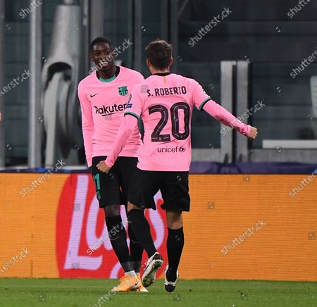 Barcelona's Ousmane Dembele (L) celebrates the goal with Sergi Roberto during the UEFA Champions League Group G match between Juventus and Barcelona in Turin, Italy, Oct. 28, 2020.