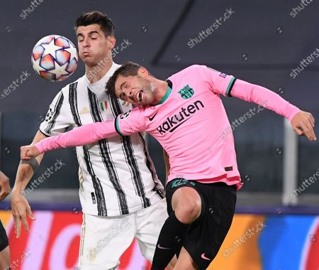 Juventus' Alvaro Morata (L) vies with Barcelona's Sergi Roberto for a header during the UEFA Champions League Group G match between Juventus and Barcelona in Turin, Italy, Oct. 28, 2020.