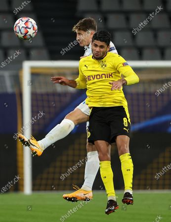 Stock Picture of Mahmoud Dahoud (front) of Dortmund vies for a header with Daler Kuzyayev of Zenit during the UEFA Champions League Group F football match between Borussia Dortmund and FC Zenit in Dortmund, Germany, Oct. 28, 2020.