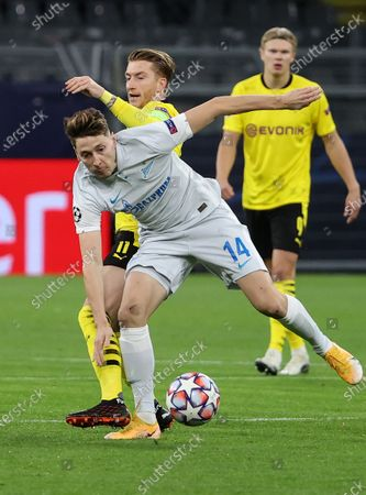 Stock Image of Marco Reus (C) of Dortmund vies with Daler Kuzyayev of Zenit during the UEFA Champions League Group F football match between Borussia Dortmund and FC Zenit in Dortmund, Germany, Oct. 28, 2020.