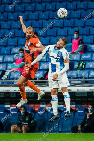 Espanyol's David Lopez (R) vies with Ponferradina's Yuri de Souza during a Spanish league match between RCD Espanyol and SD Ponferradina in Barcelona, Spain, on Oct. 28, 2020.