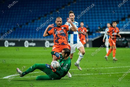 Espanyol's Diego Lopez (Bottom) saves the ball during a Spanish league match between RCD Espanyol and SD Ponferradina in Barcelona, Spain, on Oct. 28, 2020.