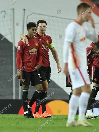 Marcus Rashford scores his 2nd for Man Utd 3-0 and is congratulated by skipper Harry Mcguire