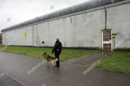 Dog Patrols At High Security Block At Belmarsh Prison Woolwich London Claudia Sturt Prison Governor At Belmarsh Prison Woolwich London The Governor Of High-security Belmarsh Prison Told Today Of The Challenge Of Having Suspected Would-be Suicide Bombers As Inmates. Claudia Sturt Defended The Jail As It Was Criticised In An Official Report For The Way It Deals With Muslim Inmates. Prisons Chief Inspector Anne Owers Warned That Belmarsh - Britain's Most Secure Prison - Is Struggling To Cope With A Large Number Of Terror Suspects And Dangerous Offenders. Her Report Says That Muslim Gangs Are Operating In The Prison And There Is Bullying And Evidence Of Black And Ethnic Minority Inmates Receiving Worse Treatment Than Whites. It Also Raises Concern Over A Decision To Prevent The Four Men Charged Over The 21 July Failed London Bombings From Attending Friday Prayers With Other Muslims And From Mixing With Fellow Inmates. Ms Owers Also Criticises How A Fifth Inmate Charged With Terrorist Offences Is Kept In Total Isolation. But Ms Sturt 38 Said That The Prison Had Faced An Unprecedented Situation And That She Would Do The Same Again With The 21 July Suspects.
