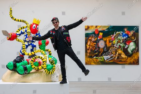 Artist Philip Colbert poses at the press preview of his Coronavirus lockdown inspired exhibition,  'Lobsteropolis' at the Saatchi gallery in London, Britain, 29 October 2020.  Visitors can attend in person but also connect to a robot via a smartphone or computer to view the exhibition remotely. Born from isolation and the severance of human connection through social distancing, Colbert wanted to create a lockdown-proof concept, which aims to transport visitors through an odyssey of unseen large-scale paintings and sculptures.