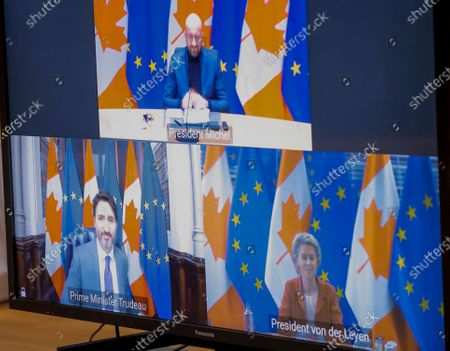 European Council President Charles Michel (Top), European Commission President Ursula Von Der Leyen (Dw R) and Prime Minister of Canada Justin Trudeau (Dw L) are seen on screens at the start of a virtual EU - Canada Summit in Brussels, Belgium, 29 October 2020.