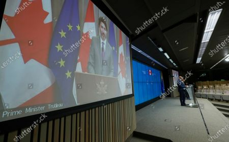 European Council President Charles Michel (R) and Prime Minister of Canada Justin Trudeau (L) on screen during a press conference following a virtual EU - Canada Summit in Brussels, Belgium, 29 October 2020.