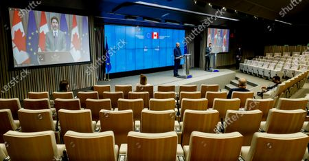 European Council President Charles Michel (C) and Prime Minister of Canada Justin Trudeau (L) on screen during a press conference following a virtual EU - Canada Summit in Brussels, Belgium, 29 October 2020.